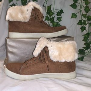 Tan sneaker with fuzzy detailing